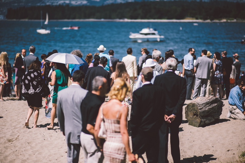 wedding guests meeting at kitsilano beach for wedding