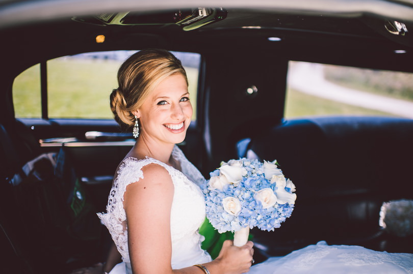 Bride in limo on wedding day