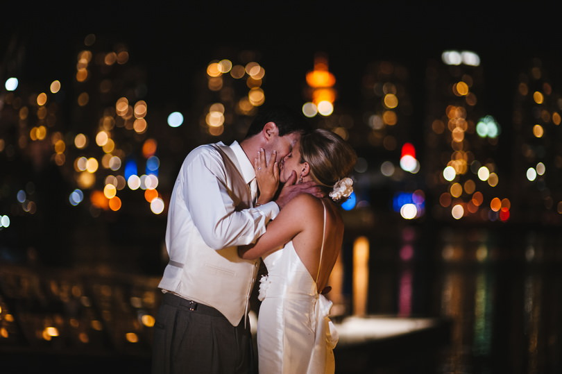 wedding photography taken at night with the city in the background