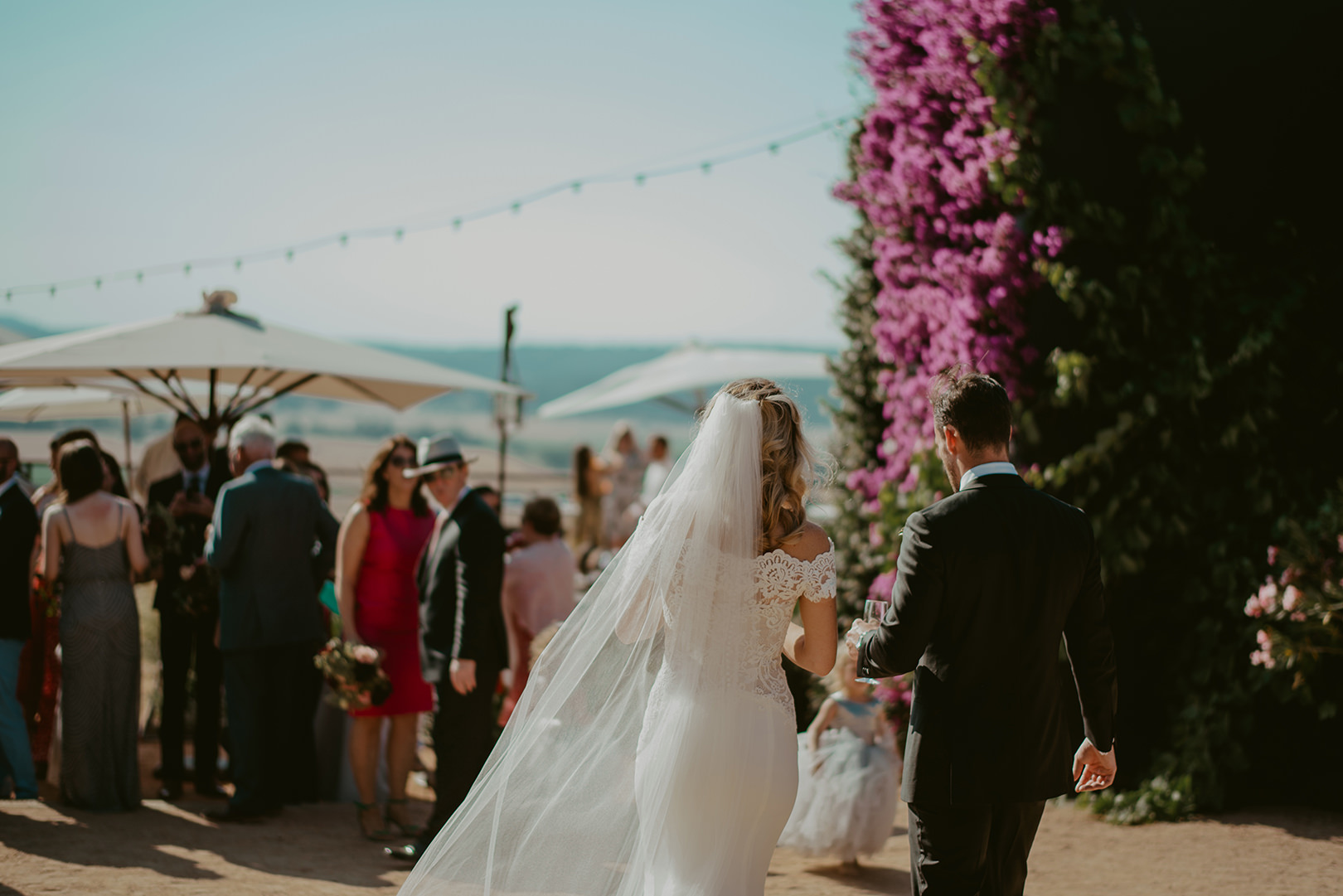 Bride and groom entering reception in Spain