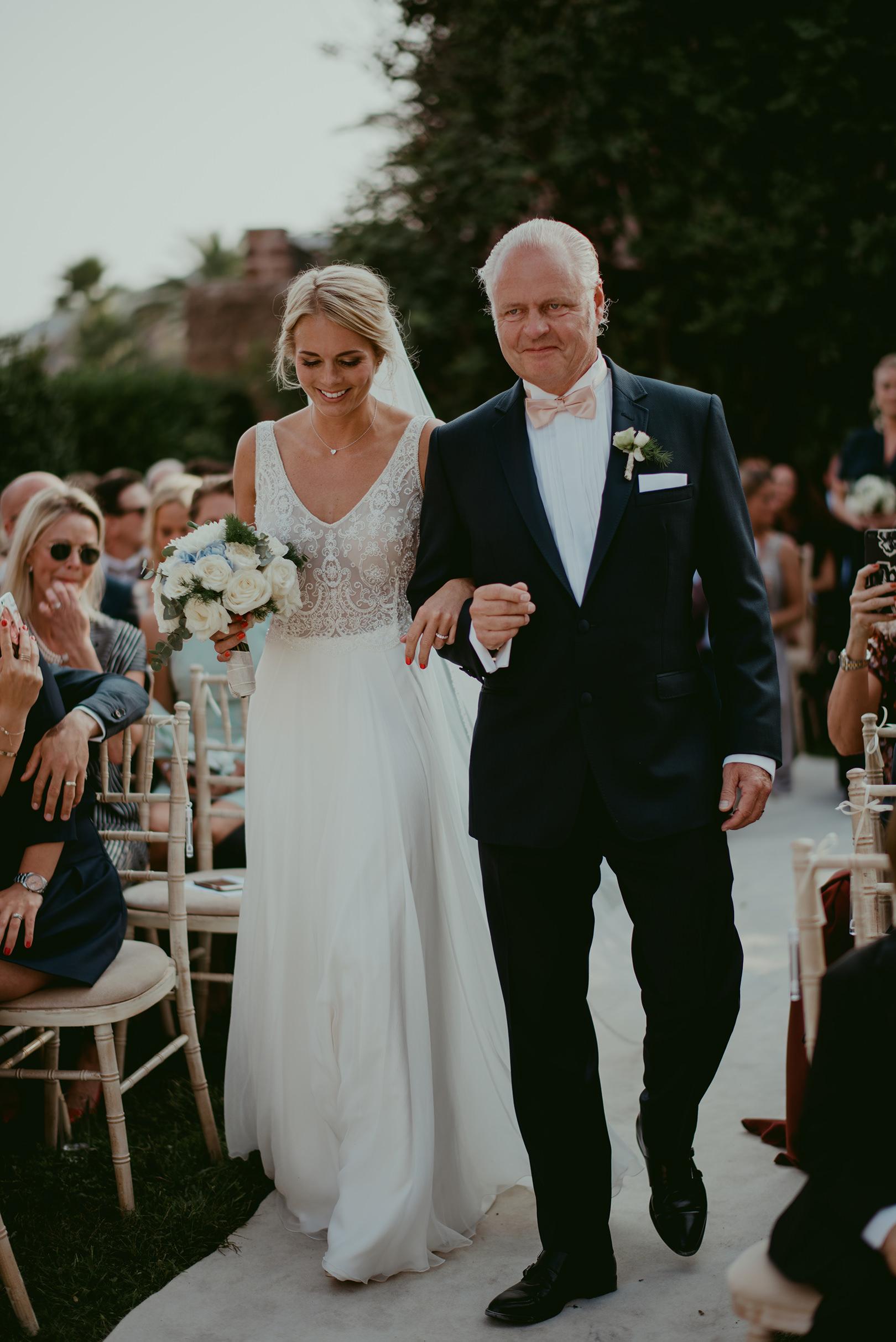 Bride and Father walking down the ailse at Chateau de la Napoule Cannes