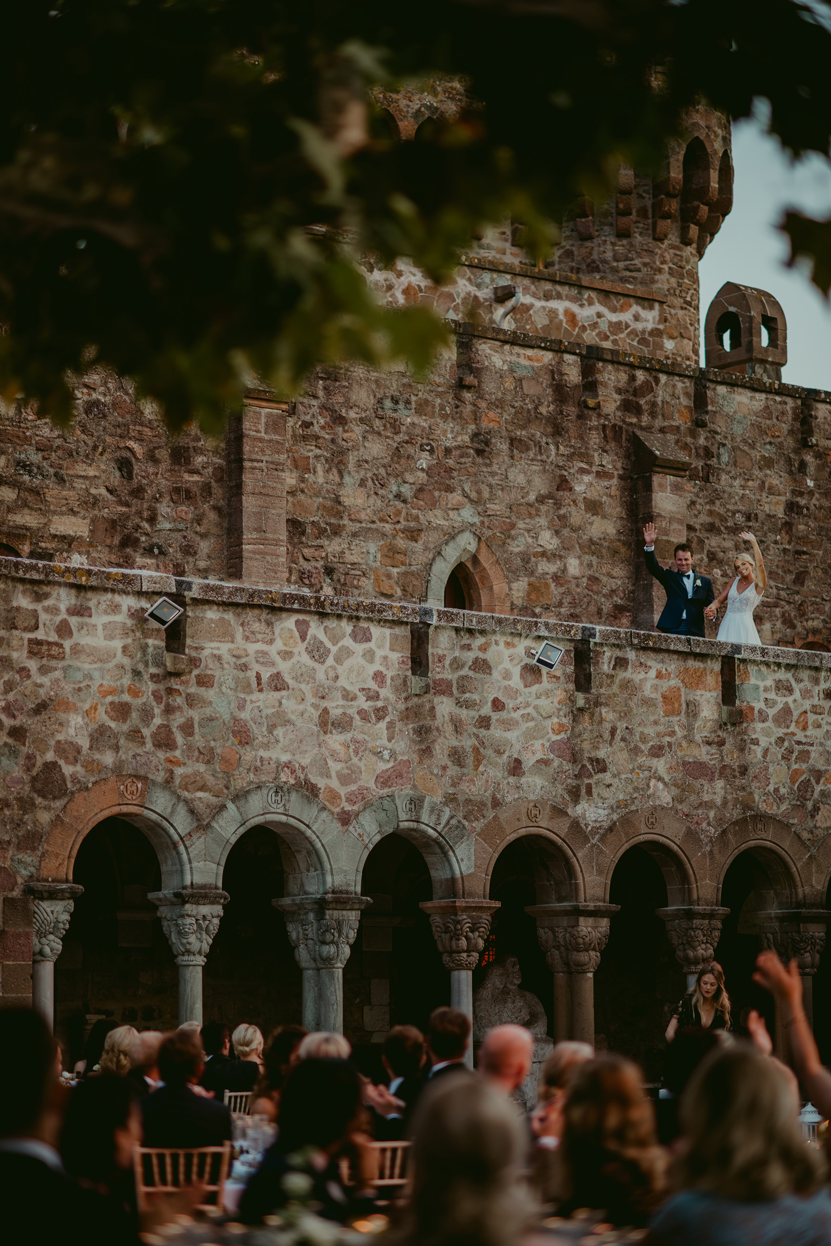Bride and groom greeting guests at Chateau de la Napoule